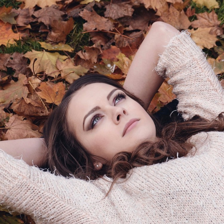 lady laying in leaves