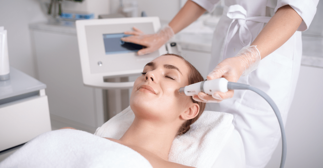 A woman receiving a cosmetic laser treatment for her acne.