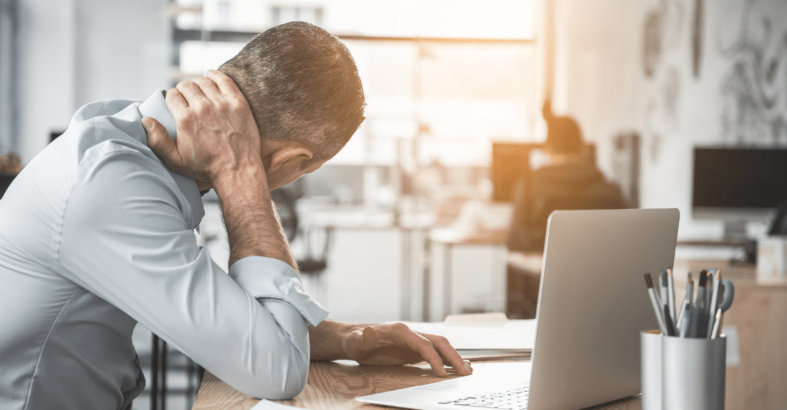 Man with neck pain at work