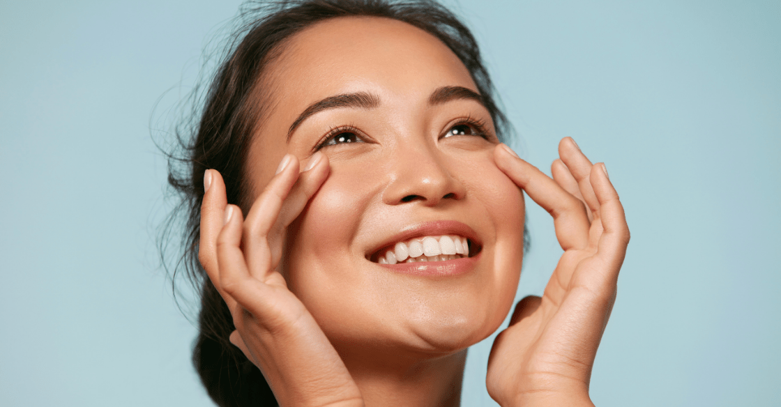 Happy woman touching her face