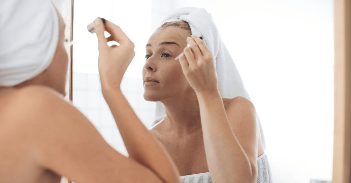 woman applying skincare at home